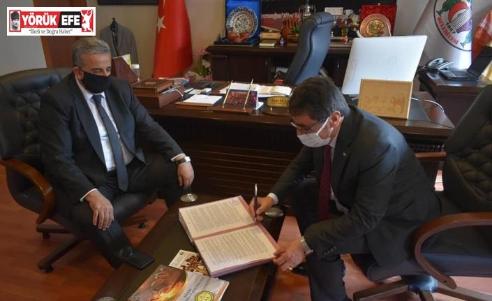 Karacasu'da anlamlı imza töreni